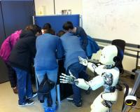 students play hide and seek with a humanoid robot